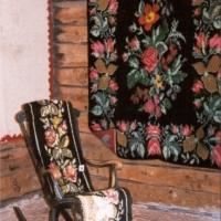 Dubbelnockad rya från 1900-talets början samt en gungstolsrya